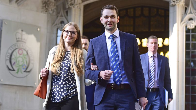 Ashers Bakery owners Amy and Daniel McArthur outside the Supreme Court in London, on Oct. 10, 2018.(Victoria Jones/PA via AP)