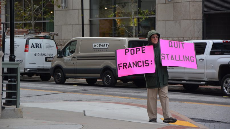 A lone protester stands outside the U.S. Conference of Catholic Bishops meeting in Baltimore on Nov. 13 2018. RNS