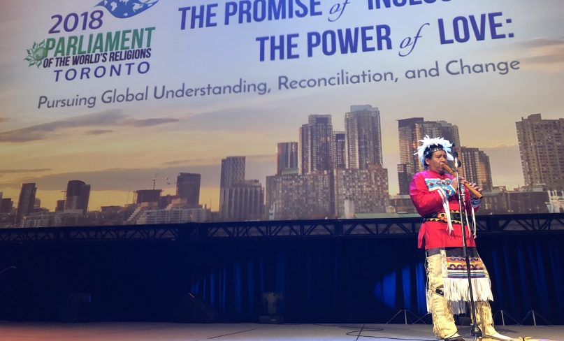 An indigenous person plays for the audience at the opening ceremonies of the 2018 Parliament of the World's Religions in Toronto, Canada on November 1, 2018. (RNS photo by John Longhurst.