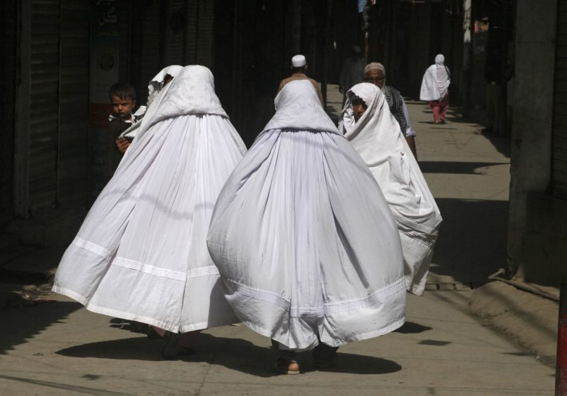 Pakistani Shiite Muslim women on their way to attend a Muharram procession in Peshawar, Pakistan, on Sept. 13, 2018. Muharram, the first month of the Islamic calendar, is a month of mourning in remembrance of the martyrdom of Imam Hussein, the grandson of Prophet Mohammed. (AP Photo/Muhammad Sajjad)