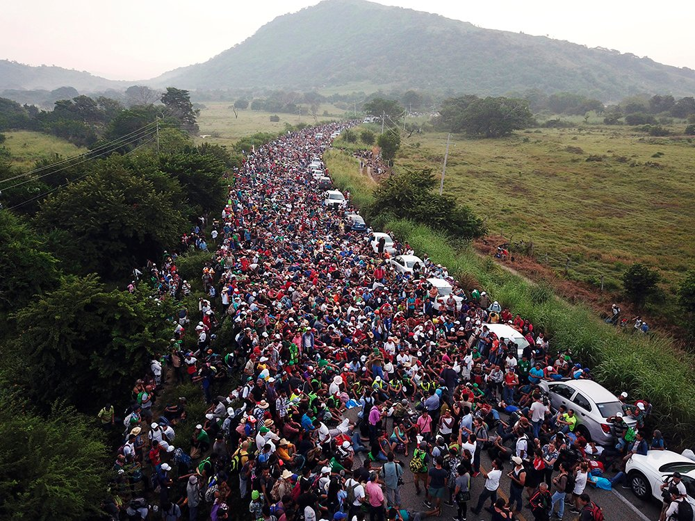 Members of a US-bound migrant caravan stand on a road after federal police briefly blocked their way outside the town of Arriaga, Mexico, on Oct. 27, 2018. Hundreds of Mexican federal officers carrying plastic shields had blocked the caravan from advancing toward the United States after several thousand of the migrants turned down the chance to apply for refugee status and obtain a Mexican offer of benefits. (AP Photo/Rodrigo Abd)