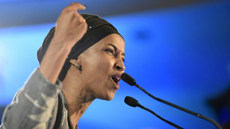 Democrat Ilhan Omar speaks after winning in Minnesota's 5th Congressional District race during the election night event held by the Democratic Party on Nov. 6, 2018, in St. Paul, Minn. (AP Photo/Hannah Foslien)