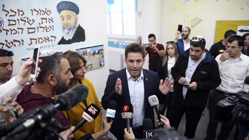 Mayoral candidate Ofer Berkovitch talks to media at a polling station during the municipal elections in Jerusalem on Oct. 30, 2018. (AP Photo/Oded Balilty)
