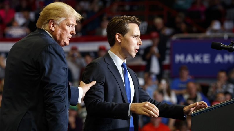 Republican Senate candidate Josh Hawley is guided to the podium to speak by President Trump during a rally at the Show Me Center on Nov. 5, 2018, in Cape Girardeau, Mo. (AP Photo/Carolyn Kaster)