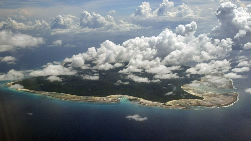 Clouds hang over the North Sentinel Island, in India's southeastern Andaman and Nicobar Islands, on Nov. 14, 2005. A rights group that works to protect tribal people has urged Indian authorities to abandon efforts to recover the body of John Allen Chau, an American man who was killed by inhabitants of an island where outsiders are effectively forbidden by Indian law. (AP Photo/Gautam Singh)