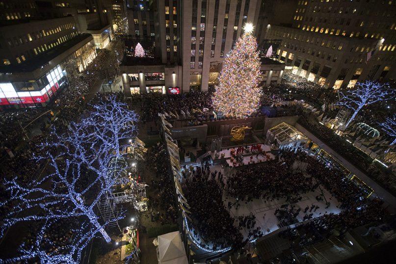 The Rockefeller Center Christmas tree is lit during the 86th annual Rockefeller Center Christmas tree lighting ceremony on Nov. 28, 2018, in New York. (AP Photo/Mary Altaffer)