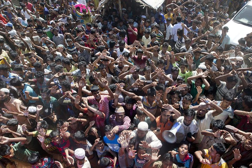 Rohingya refugees shout slogans during a protest against the repatriation process at Unchiprang refugee camp, near Cox's Bazar, in Bangladesh, on Nov. 15, 2018. (AP Photo/Dar Yasin)