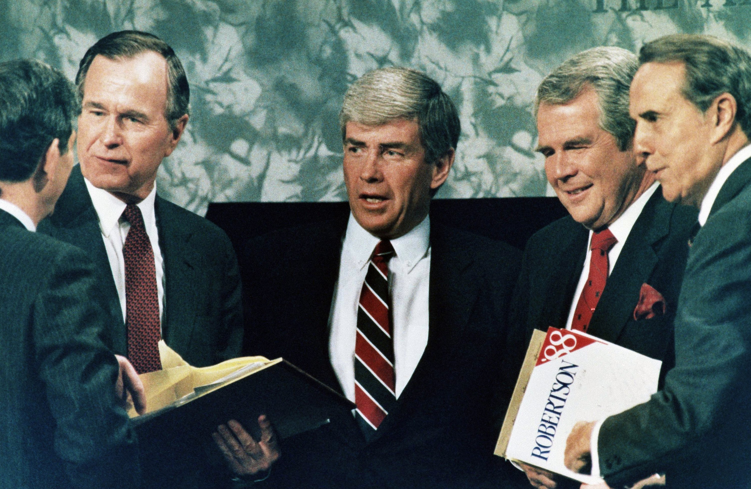 Republican presidential candidates in 1988 included, from left, Vice President George Bush, Rep. Jack Kemp, Pat Robertson, and Sen. Robert Dole after a debate in Atlanta on Feb. 28, 1988. (AP Photo)