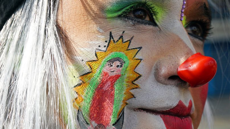 The clown Bobalín includes a face painting of the Virgin of Guadalupe while participating in a pilgrimage to the Basilica of Our Lady of Guadalupe in northern Mexico City. RNS photo by Irving Cabrera Torres