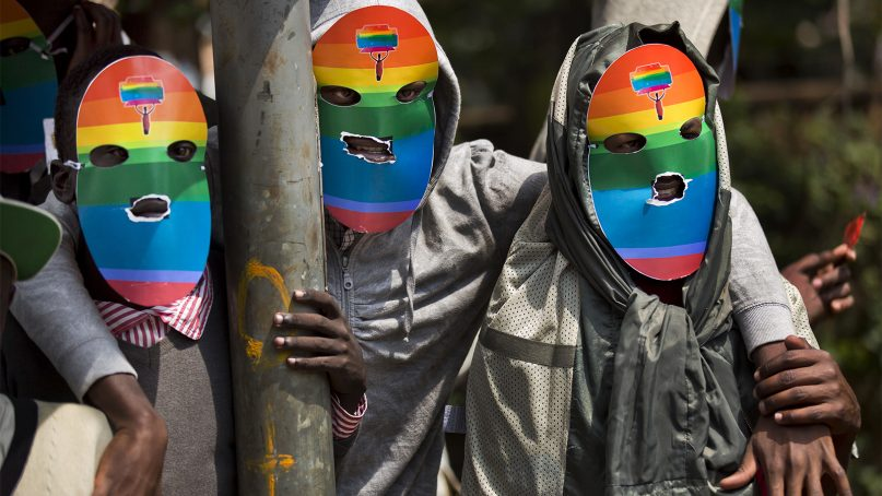 LGBT members and advocates wear masks for anonymity as they stage a rare protest, opposing many African nations' tough stances against homosexuality, in Nairobi, Kenya, on Feb. 10, 2014.  (AP Photo/Ben Curtis)
