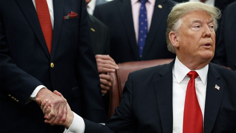 President Trump shakes hands after a signing ceremony in the Oval Office of the White House on Dec. 21, 2018, in Washington, D.C. (AP Photo/Evan Vucci)