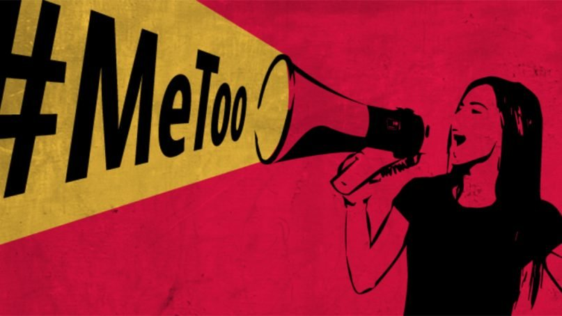 A woman uses a megaphone to express #MeToo. Graphic by Prentsa Aldundia/Creative Commons