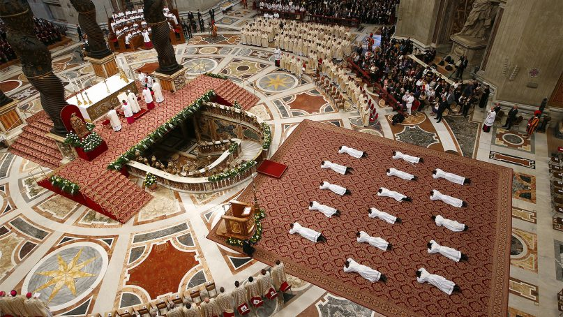 New priests lie facedown on the floor during an ordination ceremony presided over by Pope Francis, in St. Peter's Basilica at the Vatican, on April 22, 2018. (Tony Gentile/Pool Photo via AP)