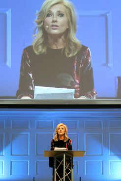 Beth Moore addresses attendees at the summit on sexual abuse and misconduct at Wheaton College on Dec. 13, 2018. RNS photo by Emily McFarlan Miller