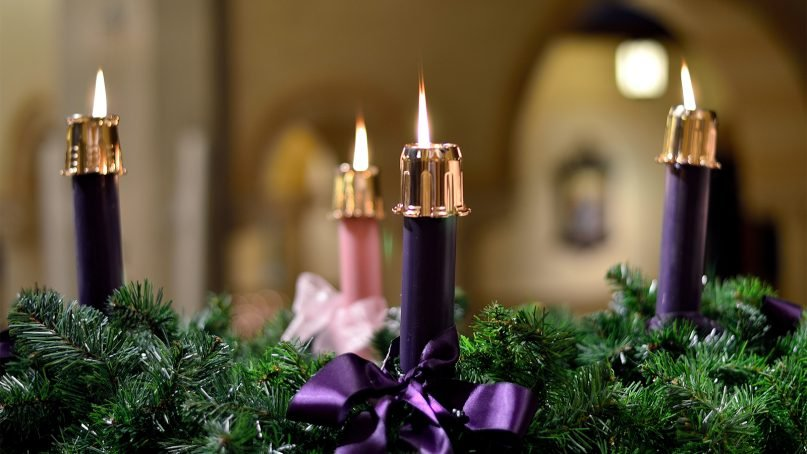 An fully lit Advent wreath. Photo by Steve Grant/Creative Commons