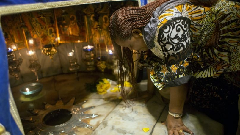 A Christian worshipper prays at the Grotto, under the Church of the Nativity, traditionally recognized by Christians to be the birthplace of Jesus Christ, in the West Bank city of Bethlehem, Sunday, Dec. 23, 2018. Christians around the world will celebrate Christmas tomorrow. (AP Photo/Nasser Nasser)