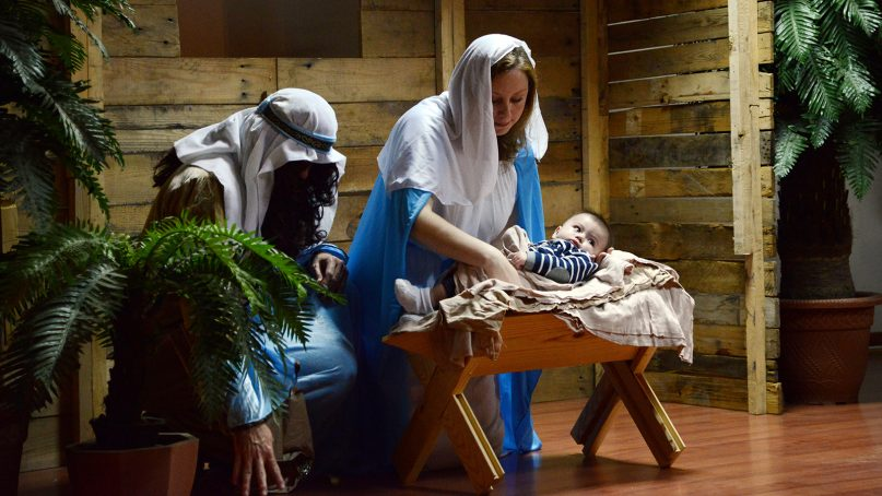 """A traditional depiction of Mary, Joseph and baby Jesus in a pageant manger scene. """"Deleted Scenes Christmas Pageant"""" skips most traditional depictions of the holy family. Photo by Tech. Sgt. Jared Marquis/U.S. Air Force/Creative Commons"""