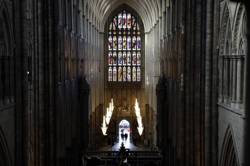 Britain's Prince Charles, front left, arrives for his visit as seen from the view of The Queen's Diamond Jubilee Galleries, described by the late British poet John Betjeman as 'the best view in Europe,' at Westminster Abbey in London, England, on Dec. 14, 2016. (AP Photo/Matt Dunham, Pool)