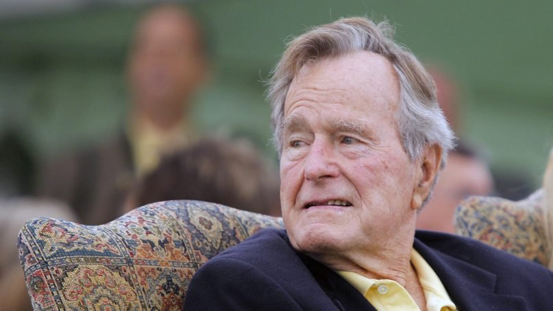 Former President Goerge H. W. Bush attends a ceremony to unveil a new garden named in his wife's honor, on Sept. 29, 2011, in Kennebunkport, Maine. Bush died on Friday, Nov. 30, 2018. (AP Photo/Robert F. Bukaty)