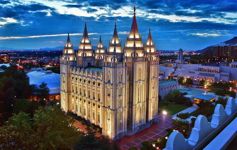 The Salt Lake Temple is illuminated at dusk in Utah. Photo by Manish Prabhune/Creative Commons