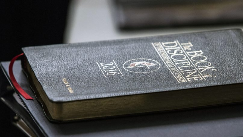 A copy of the Book of Discipline rests on a table during an oral hearing on May 22, 2018, in Evanston, Ill. The United Methodist Judicial Council, the denomination's top court, heard arguments regarding a request from the Council of Bishops for a ruling on whether United Methodist organizations, clergy or lay members can submit petitions for the special General Conference in 2019. The hearing was part of the court's May 22-25 special session. Photo by Kathleen Barry/UMNS