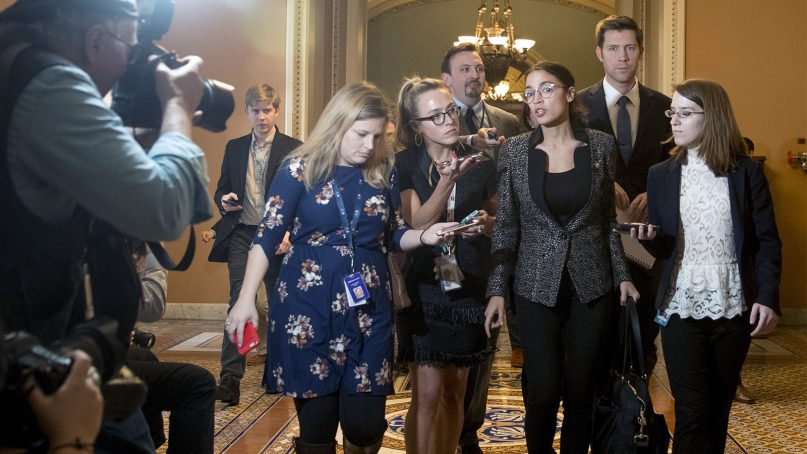 Rep. Alexandria Ocasio-Cortez, D-N.Y., third from right, speaks to reporters as she walks out of the Senate Chamber following two failed votes on ending the partial government shutdown on Capitol Hill in Washington, on Jan. 24, 2019. (AP Photo/Andrew Harnik)