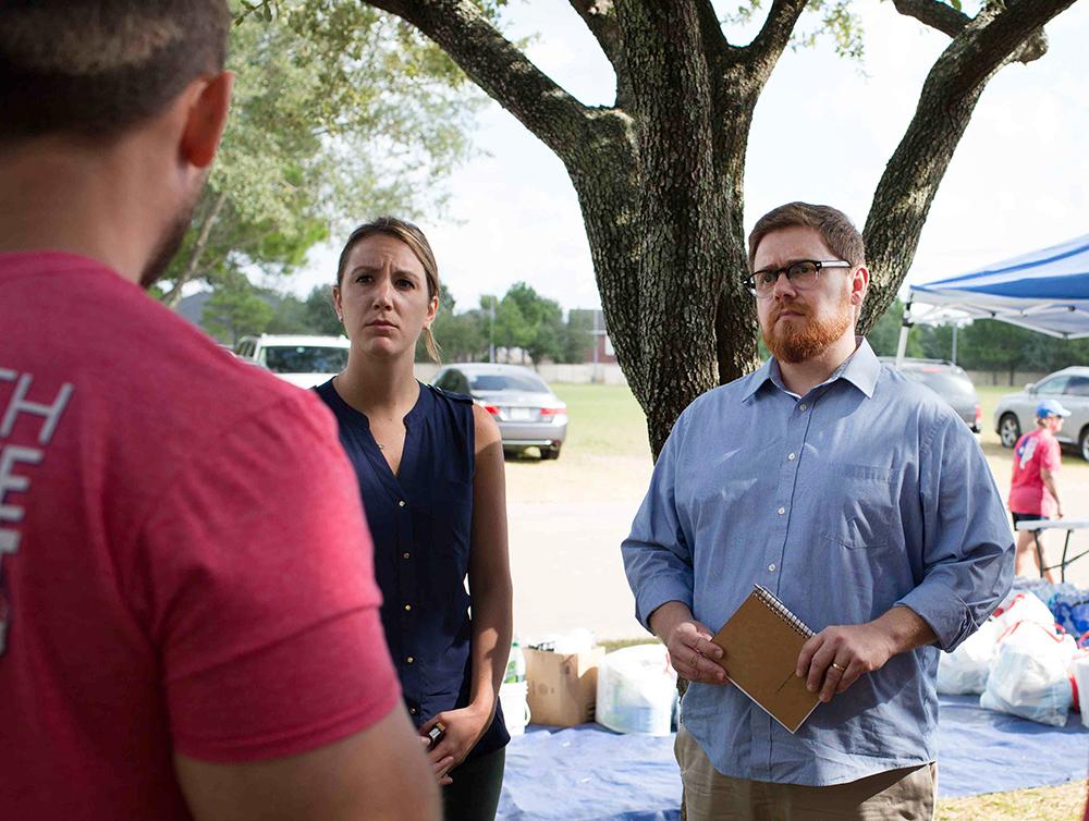 Disaster psychologist Jamie Aten, right, listens to a survivor of Hurricane Harvey in Houston, Texas, in Sept. 2017. Photo courtesy of Jamie Aten