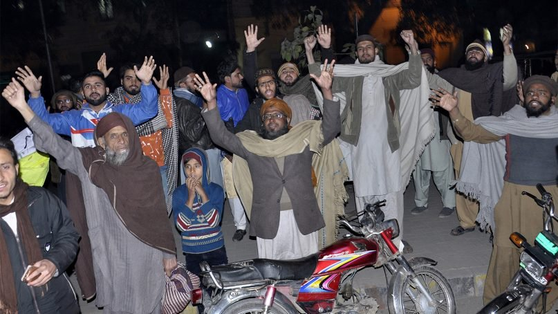 Pakistanis block a road during a protest against the acquittal of Asia Bibi, a Pakistani Christian woman who was facing blasphemy charges, in Lahore, Pakistan, on Jan. 29, 2019. Pakistan's top court on Tuesday upheld its acquittal of Bibi. Radical Islamists protesters were stymied by sweeping arrests and the deployment of a small army of police and paramilitary Rangers outside the Supreme Court in the capital, Islamabad. (AP Photo/K.M. Chaudary)