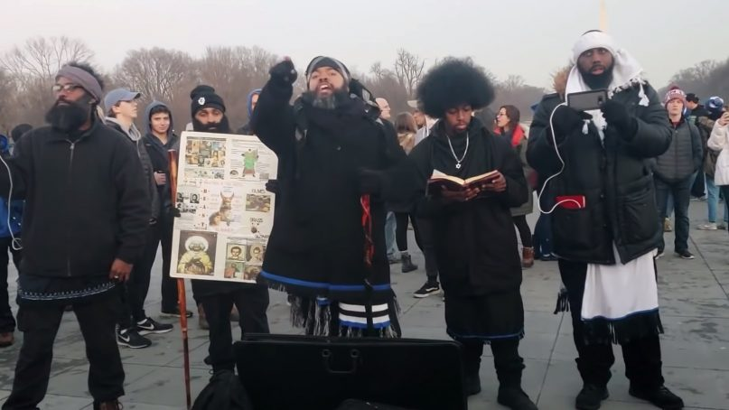 A group of men interacts with Covington Catholic High School students and other people on the National Mall on Jan. 18, 2019, in Washington. Although not specifically identified, the group is thought to be a sect of Black Hebrew Israelites. Video screenshot