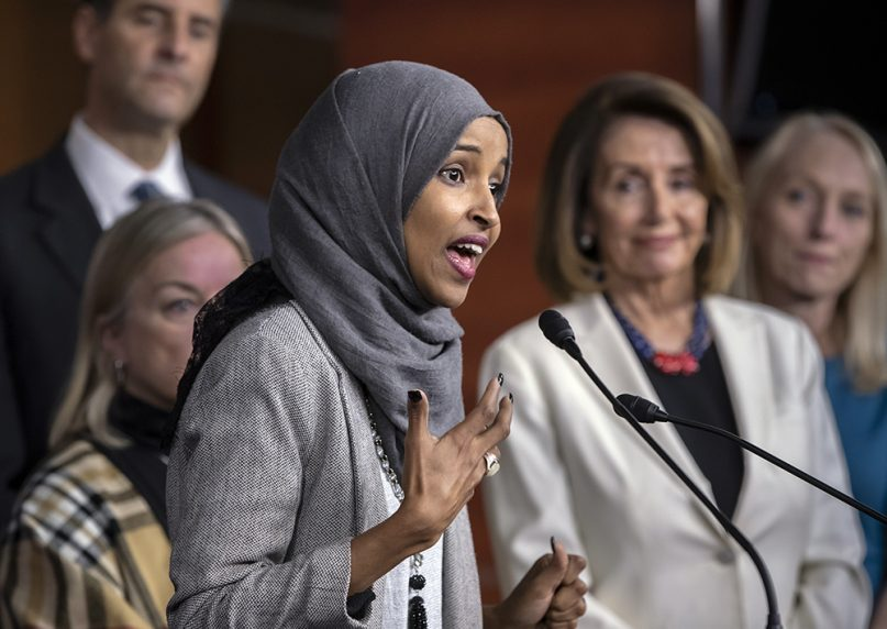 Rep.-elect Ilhan Omar, with House Democratic leader Nancy Pelosi of California, right, speaks about the party's legislative priorities when Democrats assume the majority in the 116th Congress in January, during a news conference at the Capitol in Washington, on Nov. 30, 2018. (AP Photo/J. Scott Applewhite)