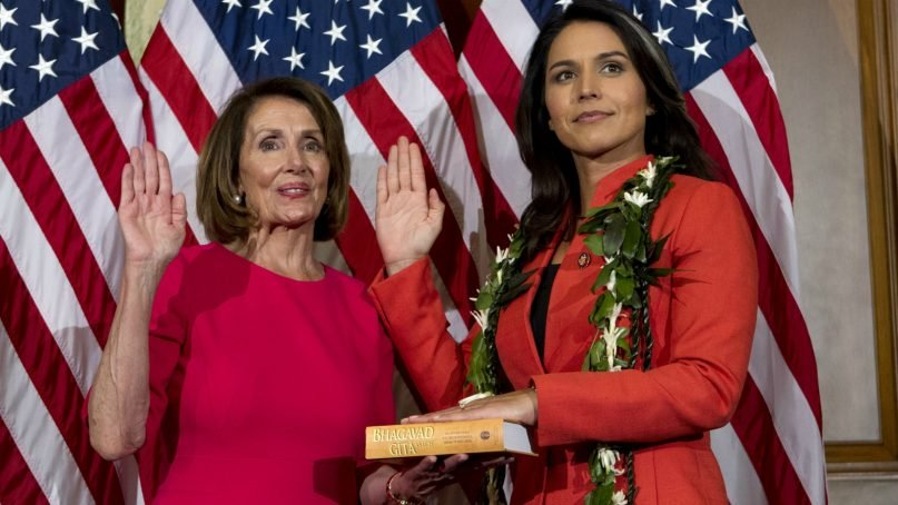 House Speaker Nancy Pelosi of California administers the House oath of office to Rep. Tulsi Gabbard, D-Hawaii, during a ceremonial swearing-in on Capitol Hill in Washington, Thursday, Jan. 3, 2019, during the opening session of the 116th Congress. (AP Photo/Jose Luis Magana)