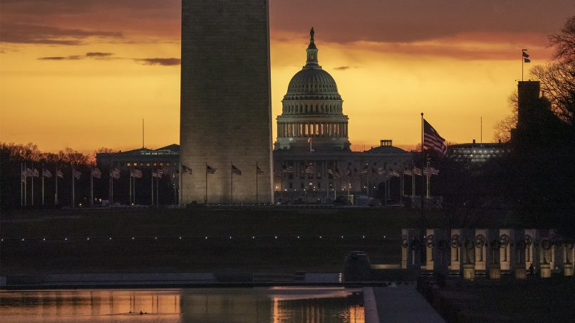 The Capitol and Washington Monument are seen at dawn as the partial government shutdown lurches into a third week with President Trump standing firm in his border wall funding demands, in Washington, on Jan. 7, 2019. After no weekend breakthrough to end a prolonged shutdown, newly empowered House Democrats are planning to step up pressure on Trump and Republican lawmakers to reopen the government. (AP Photo/J. Scott Applewhite)