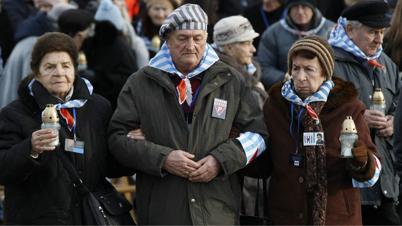Survivors of Auschwitz arrive at the International Monument to the Victims of Fascism at the former Nazi German concentration and extermination camp KL Auschwitz II-Birkenau walk to place candles on International Holocaust Remembrance Day in Oswiecim, Poland, Sunday, Jan. 27, 2019.(AP Photo/Czarek Sokolowski)