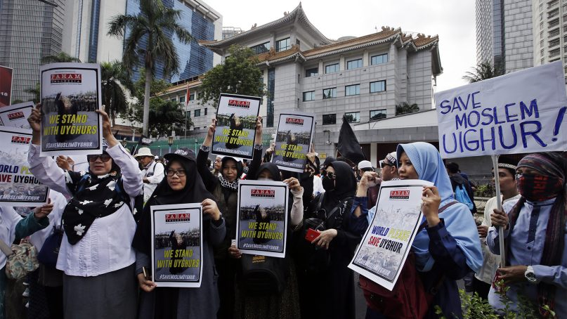 Muslim protesters rally outside the Chinese Embassy in Jakarta, Indonesia, on Dec. 21, 2018. Several hundred rallied outside the embassy in the Indonesian capital, demanding an end to mass detentions of Uighur Muslims in China. (AP Photo/Achmad Ibrahim)