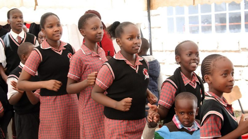 Students wear uniforms while participating in an activity at Cardinal Academy, a private Christian school, in Utawala near Nairobi, Kenya, in 2016. RNS photo by Fredrick Nzwili