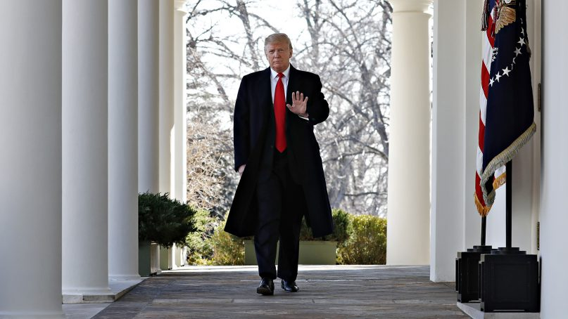 President Donald Trump waves as he walks through the Colonnade from the Oval Office of the White House to announce a deal to temporarily reopen the government on Jan. 25, 2019. (AP Photo/Jacquelyn Martin)