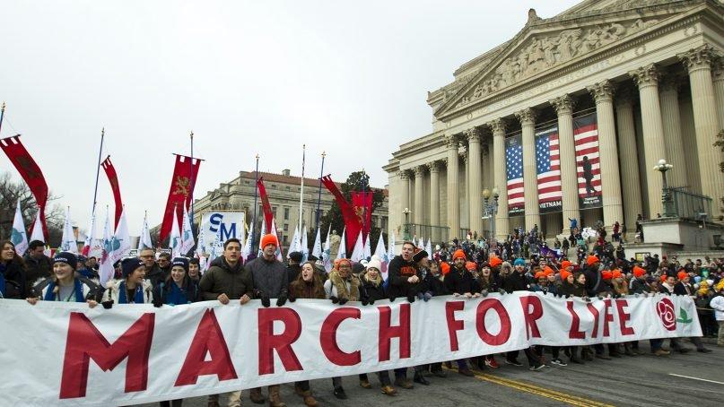 Anti-abortion activists march toward the U.S. Supreme Court during the annual March for Life in Washington, D.C., on Jan. 18, 2019. (AP Photo/Jose Luis Magana)