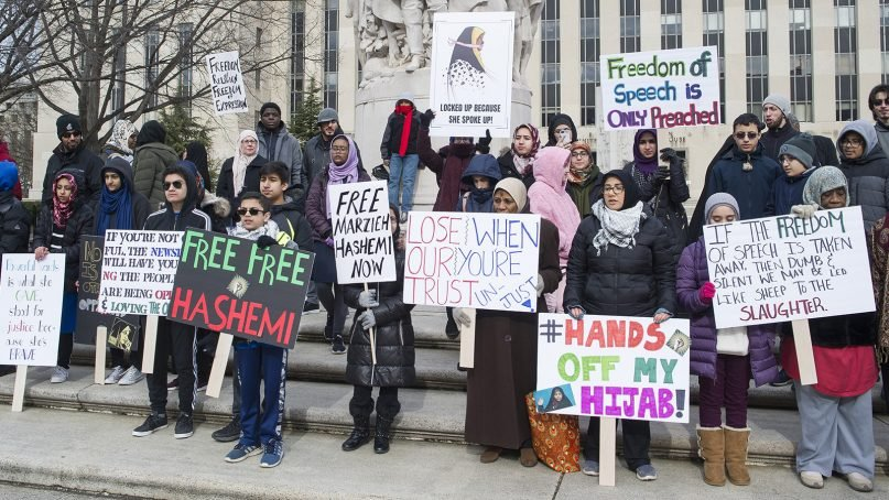 Supporters of Marzieh Hashemi, an American-born anchor for Iran's state television broadcaster, demonstrate outside the federal courthouse where Hashemi will appear before a U.S. grand jury, on Jan. 23, 2019, in Washington.  She is in custody as a material witness. (AP Photo/Cliff Owen)