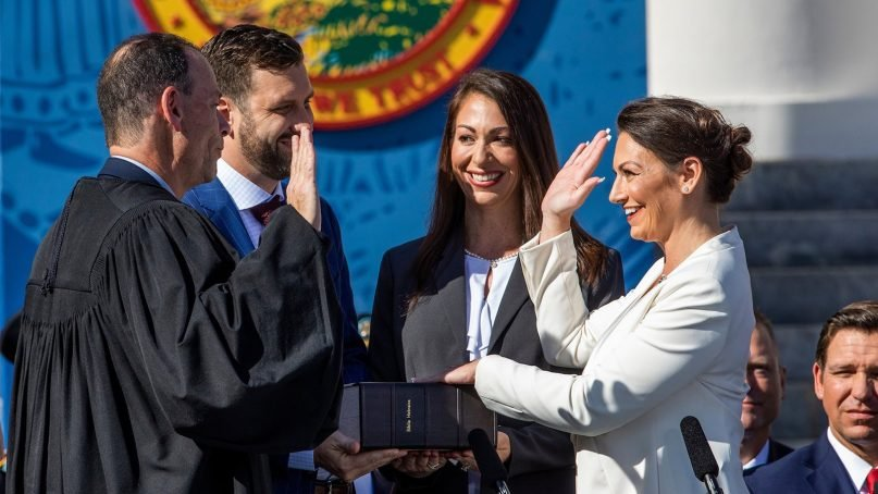 Nikki Fried, right, is sworn in as Florida's commissioner of agriculture on Jan. 8, 2019. Fried's left hand is placed on the first Hebrew Bible published in America. Photo by Colin Hackley