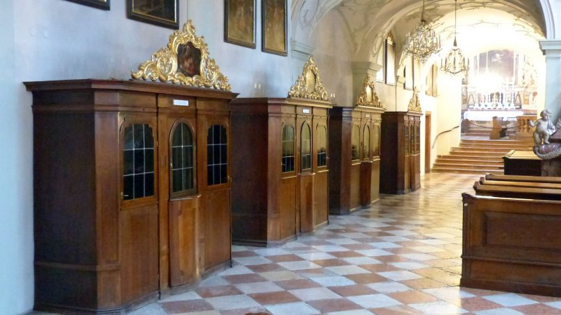 Confessionals, left, line the wall of a church. Photo courtesy of Creative Commons