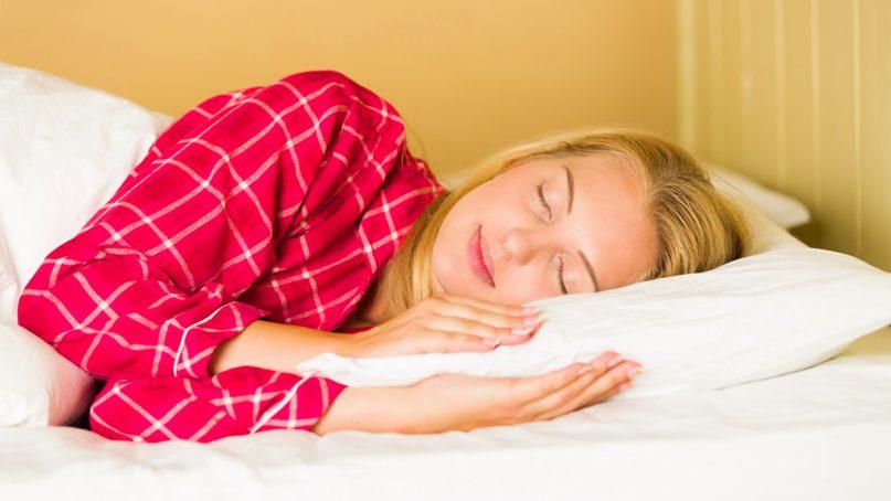 A woman sleeps peacefully.  Photo courtesy of Creative Commons
