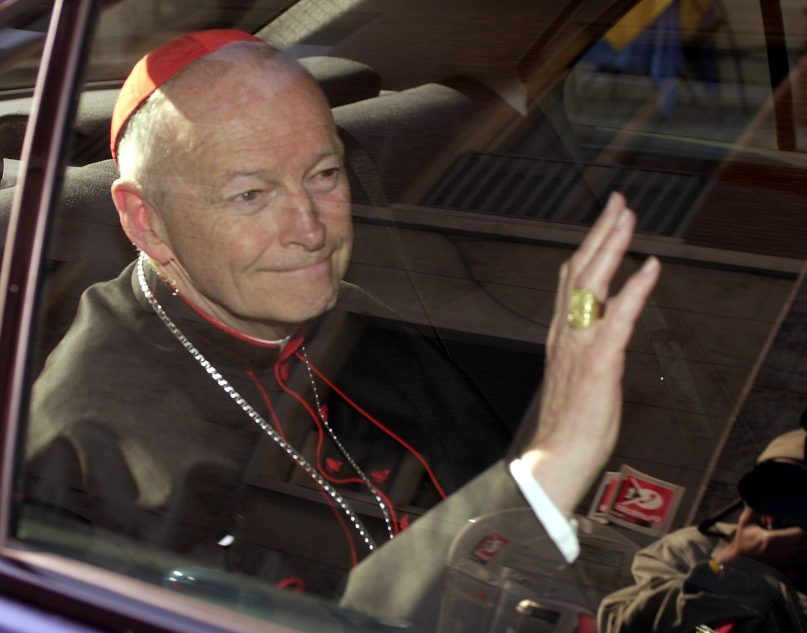 In this April 23, 2002, file photo, Cardinal Theodore McCarrick of the Archdiocese of Washington waves as he arrives at the Vatican in a limousine. On Feb. 16, 2019, the Vatican announced Pope Francis defrocked McCarrick after Vatican officials found him guilty of soliciting for sex while hearing confession. (AP Photo/Andrew Medichini, file)