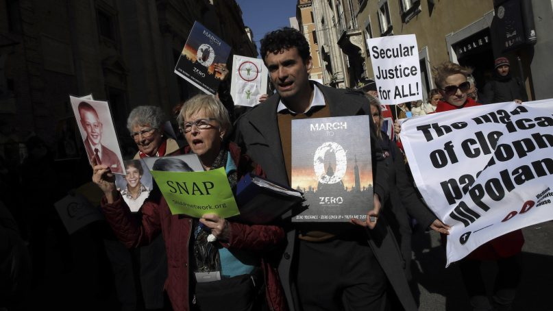 Sex abuse survivors  and members of the group Ending Clergy Abuse march in downtown Rome on Feb. 23, 2019. Pope Francis hosted a four-day summit on preventing clergy sexual abuse, a high-stakes meeting designed to impress on Catholic bishops around the world that the problem is global and that there are consequences if they cover it up. (AP Photo/Alessandra Tarantino)