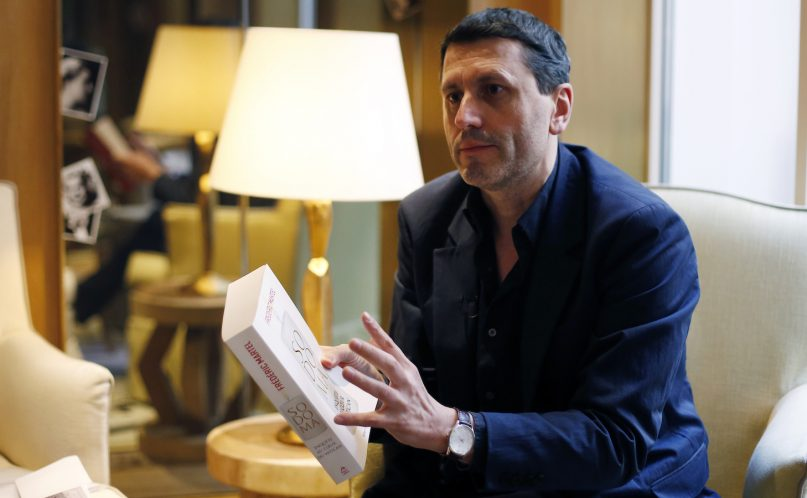 French writer Frederic Martel gestures during an interview with Associated Press, in Paris, Friday, Feb. 15, 2019. In the explosive book