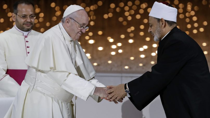 Pope Francis greets Sheikh Ahmed el-Tayeb, the grand imam of Egypt's Al-Azhar, after an interreligious meeting at the Founder's Memorial in Abu Dhabi, United Arab Emirates, on Feb. 4, 2019. Pope Francis has asserted in the first-ever papal visit to the Arabian Peninsula that religious leaders have a duty to reject all war and commit themselves to dialogue. (AP Photo/Andrew Medichini)