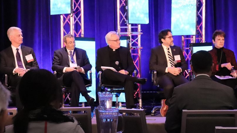 Brigham Young University President Kevin J. Worthen, from left, Yeshiva University President Ari Berman, Regis College President John Fitzgibbons, Zaytuna College President Hamza Yusuf, and Houghton College President Shirley Mullen participate in an interfaith panel on Feb. 1, 2019, during a conference of the Council for Christian Colleges and Universities at the Washington Court Hotel in Washington, D.C. RNS photo by Adelle M. Banks