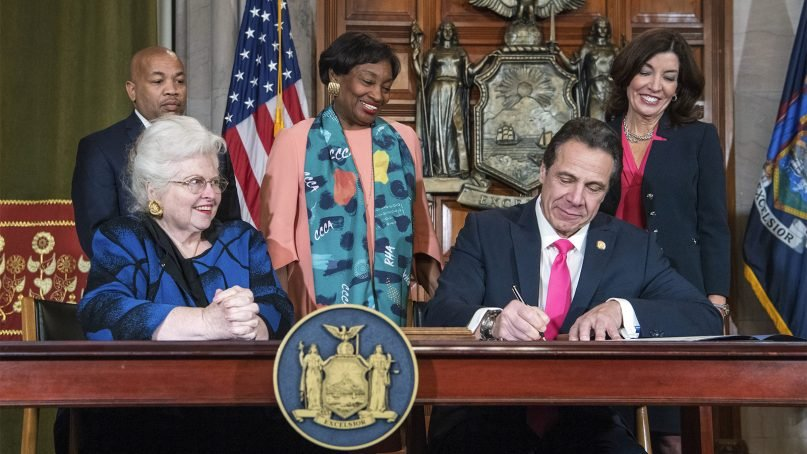 New York Gov. Andrew M. Cuomo, right, signs the Reproductive Health Act during a ceremony on Jan. 22, 2019, in the Red Room at the state Capitol in Albany, New York. With the new law, New York enacted one of the nation's strongest protections for abortion rights. Also pictured are attorney Sarah Weddington, front left, who successfully argued Roe v. Wade before the Supreme Court. Lt. Gov. Kathy Hochul is back right. (Darren McGee/Office of Gov. Andrew M. Cuomo via AP)