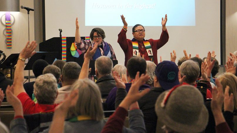 Pastors lead prayer during a service hosted by the Love Your Neighbor Coalition at the Holiday Inn in St. Louis on Feb. 27, 2019. The LGBTQ-affirming group hosted the service the morning after the special session of the UMC General Conference closed. RNS photo by Emily McFarlan Miller