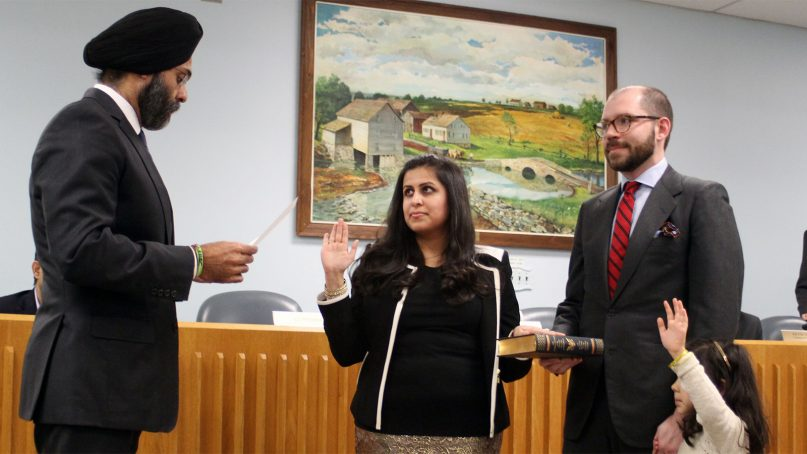 Sadaf Jaffer, center, is sworn in as the mayor of Montgomery, N.J., for 2019 as her husband and daughter look on. Her mayoral oath was administered by state Attorney General Gurbir Grewal. Photo courtesy of Montgomery Township