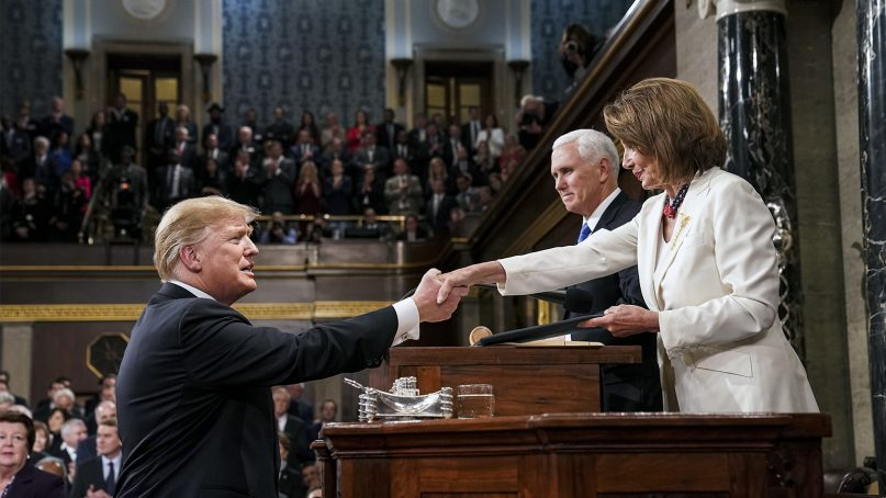 President Donald Trump shakes hands with House Speaker Nancy Pelosi, as he arrives in the House chamber before giving his State of the Union address to a joint session of Congress, on Feb. 5, 2019, at the Capitol in Washington. (Doug Mills/The New York Times via AP)
